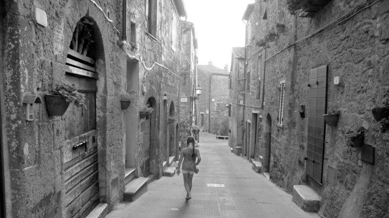 Girl walking in italian village black & white, Pitigliano, Italy -Virginie Suys Photo Canvas HD
